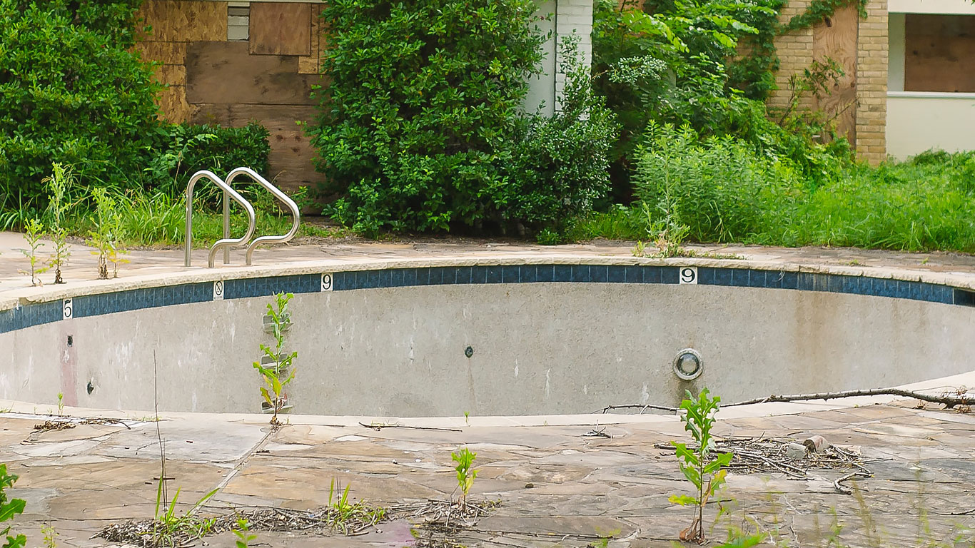 A dilapidated inground pool ready to be demolished
